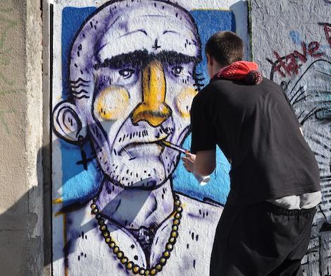 Goer finishing a graffiti character