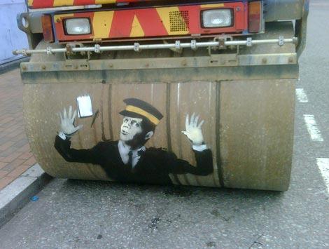 Banksy traffic warden steam roller