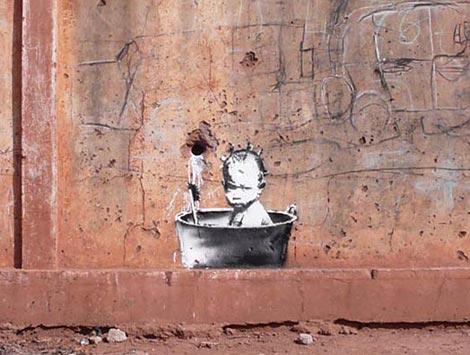Banksy baby bath graffiti